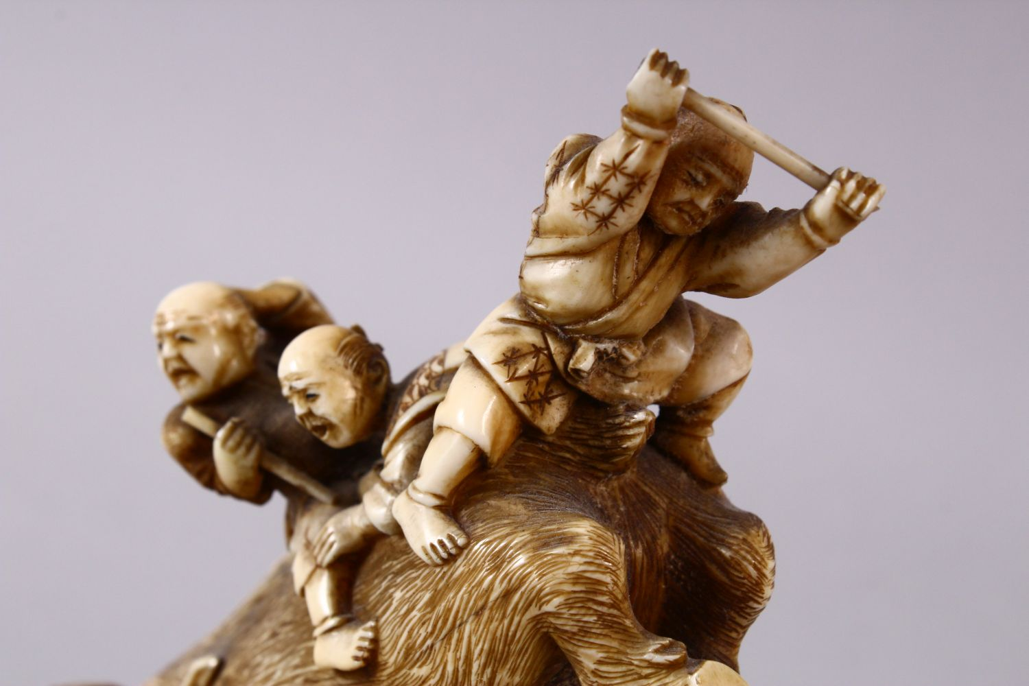 A JAPANESE MEIJI PERIOD CARVED IVORY OKIMONO GROUP- depicting a boar being attacked by numerous - Image 9 of 12
