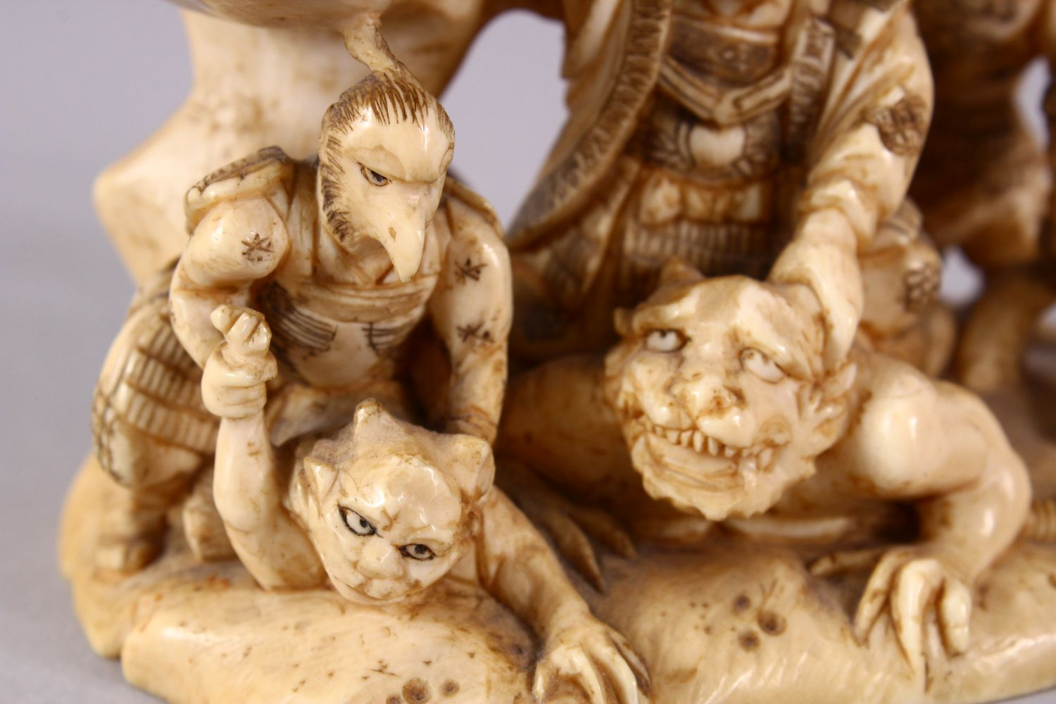 A JAPANESE MEIJI PERIOD CARVED IVORY OKIMONO GROUP - depicting figures attacking oni demons, one dog - Image 9 of 14