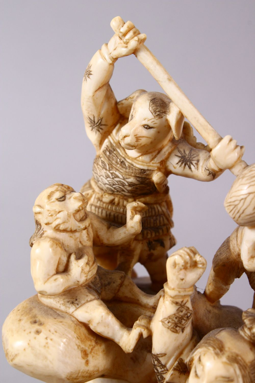 A JAPANESE MEIJI PERIOD CARVED IVORY OKIMONO GROUP - depicting figures attacking oni demons, one dog - Image 7 of 14