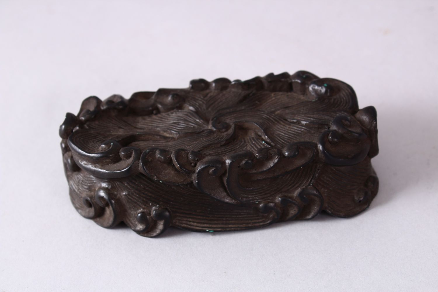 A CHINESE MOULDED WAVE STAND, in the form of crashing waves, 12cm wide x 5.5cm. - Image 2 of 3