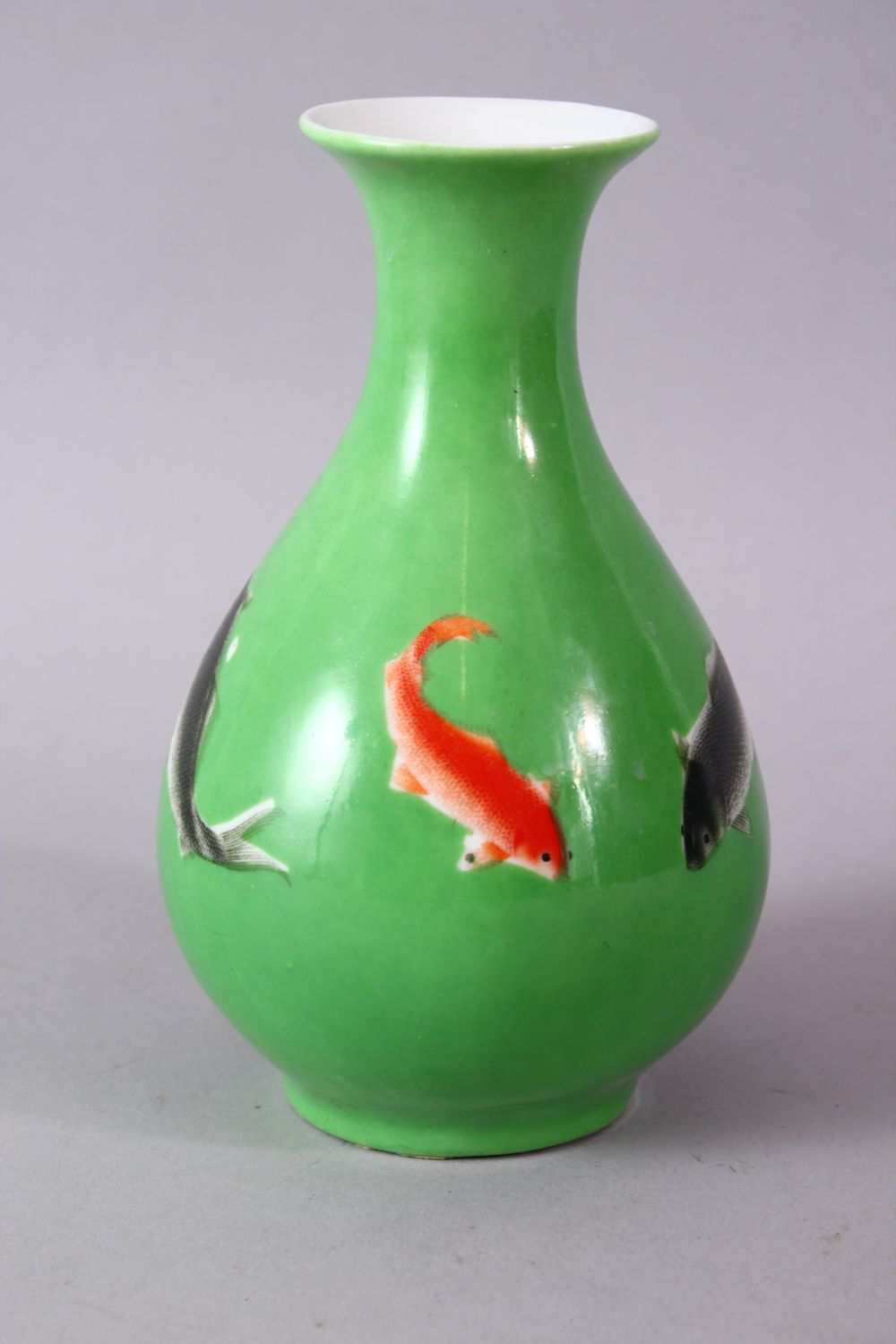 A CHINESE GREEN GLAZED VASE, painted with fish, mark in red, 15cm high. - Image 3 of 8