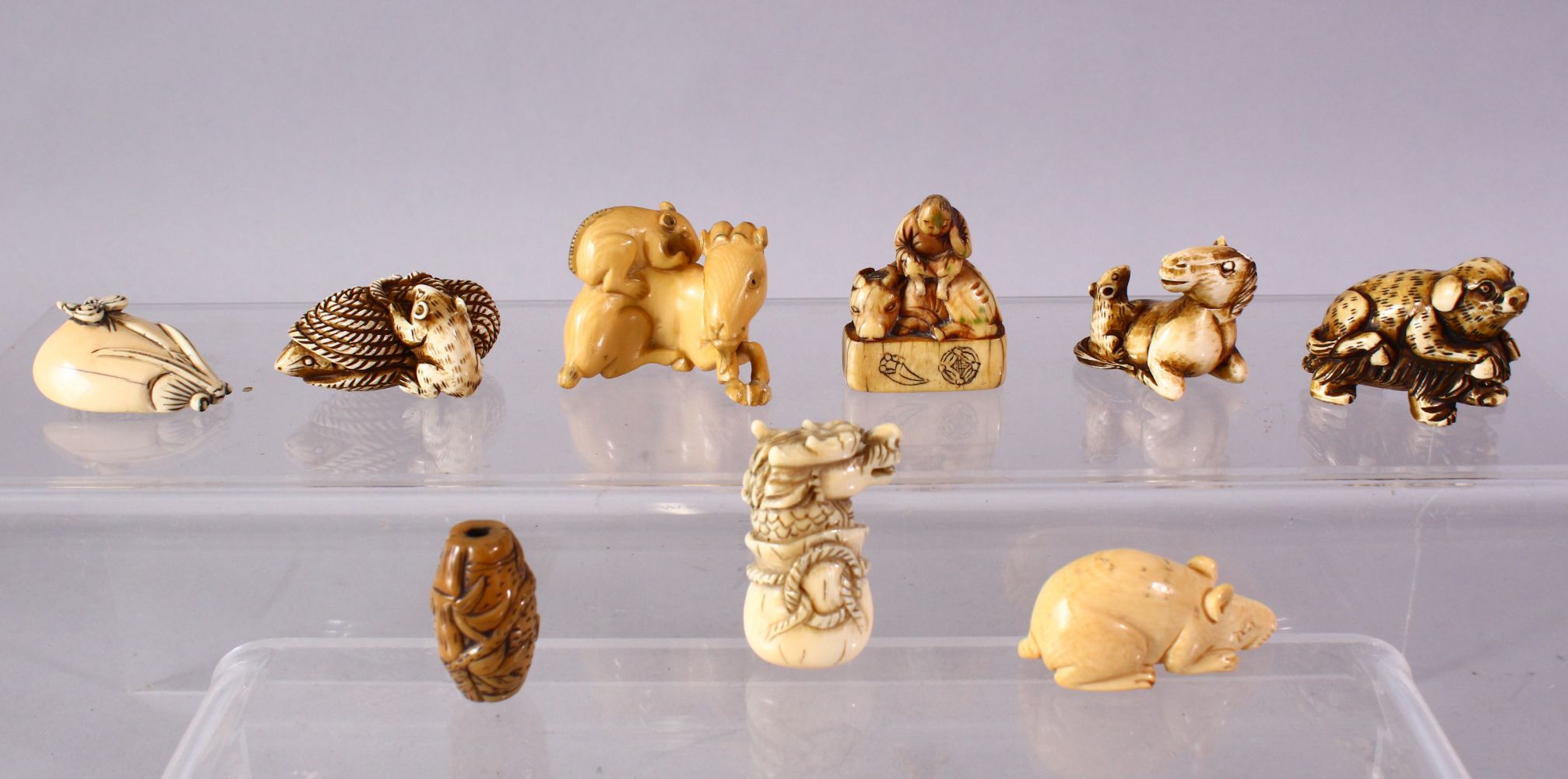 A LOT OF EIGHT JAPANESE MEIJI / EDO PERIOD CARVED IVORY NETSUKE & OJIME, one possibly later edo