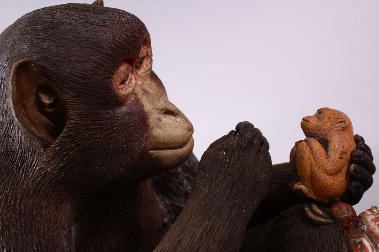 A JAPANESE POTTERY / TERRACOTTA MODEL OF A SEATED MONKEY, the monkey in a seated position holding - Image 4 of 10