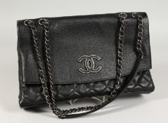 A CHANEL FOLD-UP QUILTED HANDBAG in a Chanel bag.