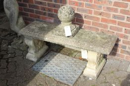 A weathered composite stone classical style bench.