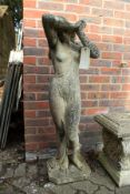 A good large weathered composite garden figure of a semi-nude female.