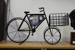 A wrought iron model of an advertising bicycle.