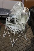 A good pair of painted wrought iron wirework armchairs.