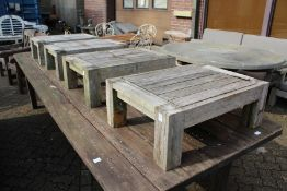 A set of four hardwood garden stools / occasional tables.