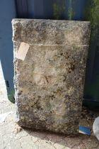 A large sandstone block.