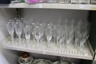 A suite of drinking glasses with frosted glass stems modelled as pairs of doves.