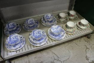 A group of Royal Worcester blue and white dragon decorated cups, saucers and plates, together with