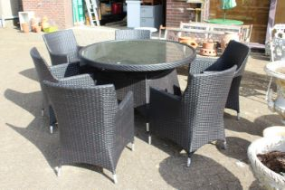 A good patio set comprising a large circular table and six armchairs, all with modern woven material