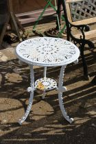 A small white painted aluminium patio table.