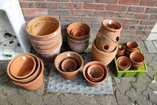 A quantity of terracotta plant pots.