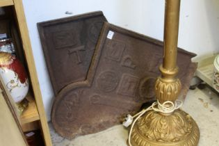 An old cast iron fireback (in two parts).