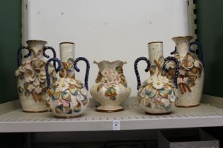 Decorative floral encrusted vases.