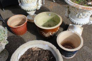 Three modern garden pots.