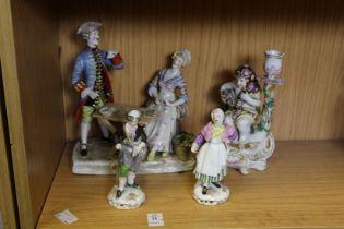 Decorative porcelain figure groups.