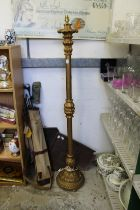 A giltwood standard lamp.