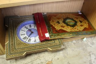 An Islamic leather blotter and a similar wall clock.
