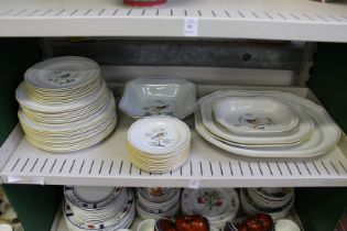 A quantity of Spode Queen's Bird china to include numerous plates and serving dishes.