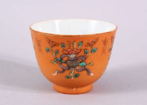A CHINESE ORANGE GROUND PORCELAIN CUP, with an orange ground and precious object decoration, the