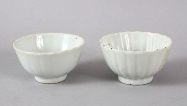 A SMALL PAIR OF CHINESE MONOCHROME WHITE PORCELAIN PETAL MOULDED BOWLS, each with a ribbed body in