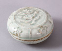 A CHINESE SONG STYLE FLORAL CYLIDRICAL BOX & COVER, with moulded floral decoration, 8cm diameter.