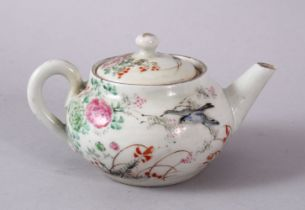 A SMALL CHINESE FAMILLE ROSE TEAPOT & COVER, decorated with native scenes of flora and birds, the