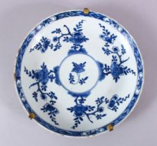 A CHINESE BLUE & WHITE PORCELAIN DISH - decorated with native floral sprays around a central