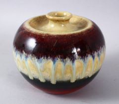 A CHINESE FLAMBE DRIP GLAZED PORCELAIN VASE, with graduating colour palate with a central drip