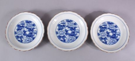 THREE JAPANESE BLUE & WHITE FUKAGAWA PORCELAIN PLATES, each with central floral underglaze blue