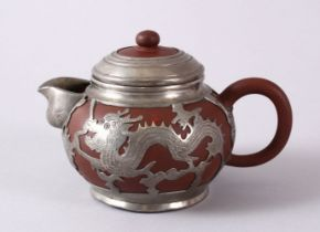 A CHINESE YIXING CLAY & WHITE METAL DRAGON TEAPOT, The body of the teapot encapsulated with a carved