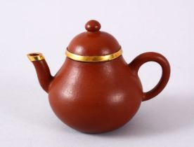 A CHINESE YIXING CLAY & GOLD METAL MOUNTED TEAPOT & COVER, the body mounted with gold coloured