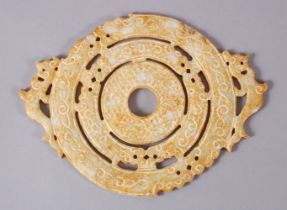 A CHINESE CARVED SOAPSTONE BI DISK, carved in archaic form with chilong, 22cm