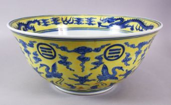 A LARGE CHINESE YELLOW & BLUE PORCELAIN DRAGON BASIN, with a yellow wash ground with a central