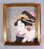 A JAPANESE WOODBLOCK PRINT OF A KABUKI ACTOR - KITAGAWA UTAMARO - depicting a posed kabuki actor