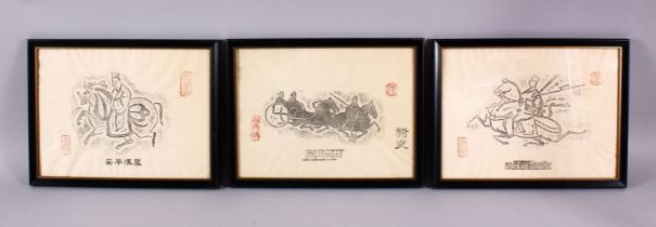 THREE FRAMED CHINESE TEMPLE RUBBINGS, each with a different view of a figure upon horses, each