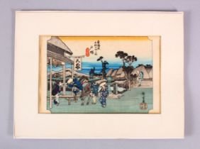 A JAPANESE WOODBLOCK PRINT - FIGURES AND HORSE - the figures stood in a windswept landscape with a