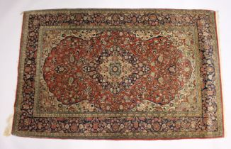 A GOOD PERSIAN RUG, early 20th Century red ground with stylised floral decoration. 7ft x 4ft 5ins.