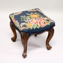 A VICTORIAN ROSEWOOD SQUARE TOP STOOL with floral needlework on cabriole legs. 1ft 1ins long.