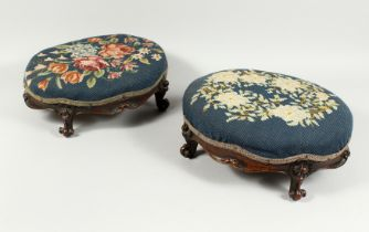 A GOOD PAIR OF VICTORIAN MAHOGANY OVAL FOOT STOOLS with needlework tops on cabriole legs. 14ins