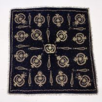 A PIECE OF TURKISH FABRIC with silver inlay on a blue ground 2ft 11ins x 3ft 1ins.