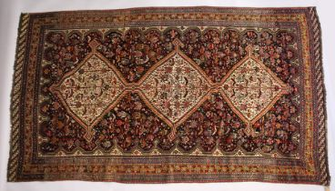 A GOOD LARGE EARLY 20TH CENTURY QASHQAI CARPET with three central diamond shaped, decorated all over