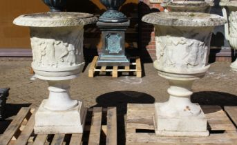 A SUPERB NEAR PAIR OF ITALIAN CARVED WHITE MARBLE URNS ON STANDS, the sides covered with dancing