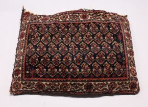A PERSIAN CUSHION 2ft 6ins x 1ft 6ins