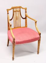 A SHERATON SATINWOOD PAINTED ARM CHAIR, with railed back, padded seat on tapering legs.