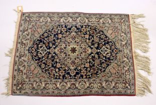 A GOOD, SMALL PERSIAN RUG, dark blue ground with stylised design 3ft 5ins x 2ft 6ins