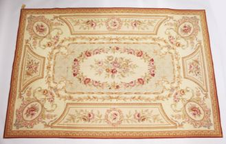 AN AUBUSSON STYLE TAPESTRY WALL HANGING, beige ground with floral decoration. 9ft x 6ft.